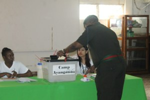 Chief of Staff of the Guyana Defence Force, Brigadier Mark Phillips casting his ballot at Base Camp Ayanganna.