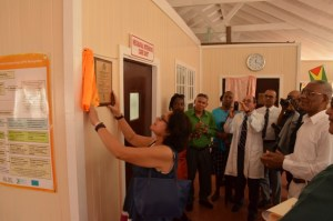 First Lady, Mrs. Sandra Granger unveils the plaque to officially commission the new Neonatal Intensive Care Unit at the Bartica Regional Hospital as President David Granger, Minister of Public Health, Dr. George Norton and other hospital officials look on.