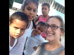 Mead, Nebraska, native Emily Garcia with some of her students in the village of Malali, Guyana, in South America. The Peace Corps worker has one more year of service in the village, where she teaches reading and other fundamentals to 35 students ranging in age from preschool to preteen.