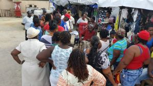 A group of vendors at Parliament View Saturday afternoon (August 13, 2016) listen attentively to President of the Guyana Market Vendors Union, Eon Andrews.
