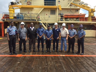 Members of the GDF Coast Guard and Edison Chouest Offshore LLC officials.