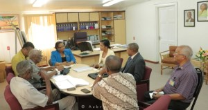 NCN's Chief Executive Officer, Lennox Cornette in jacket, accompanied by Human Resources Manager, Tishika De Costa and Programme Manager, Ron Robinson meeting with the two Ministers responsible for Labour and other top officials of the Department of Labour.