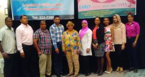President of the GCF (center), Bibi Hassan flanked by members and sponsors.