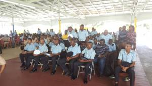 The few  members of the police force, who stood up, to indicate that they were taking notes during the Police Commissioner, David Ramnarine's address.