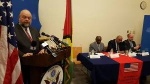 US Ambassador, Perry Holloway at the lectern. Seated are (left to right) Guyana's  Foreign Minister, Carl Greenidge; Natural Resources Minister, Raphael Trotman and Carter Centre's Country Representative, Jason Calder.