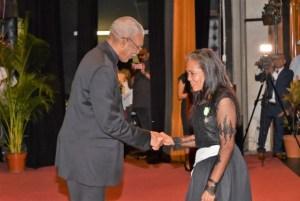 Senior Confidential Secretary to the President in the Ministry of the Presidency, Ms. Nancy Ferreira receives her Medal of Service from President David Granger