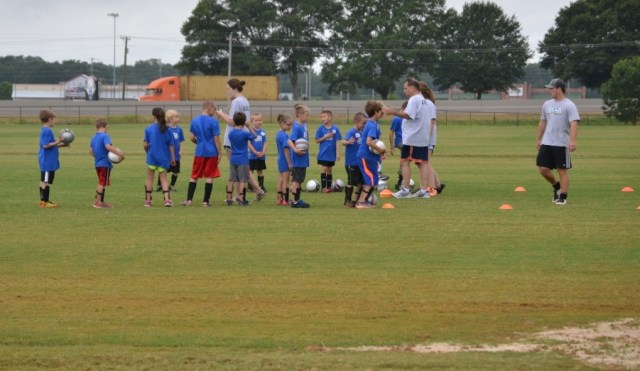 Campers participate in soccer drills at Mega Sports Camp.