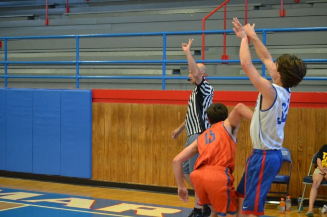 Kelton Hall of Ingomar drains a three from the corner during the last day of summer basketball at Ingomar. Photo by Dennis Clayton.