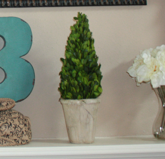 swing into spring mantel boxwood