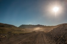 dusty-road-heading-to-the-pass-in-the-early-sun