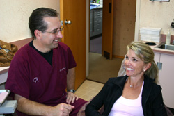 Patient discusses the dental implant experience with the prosthodontist