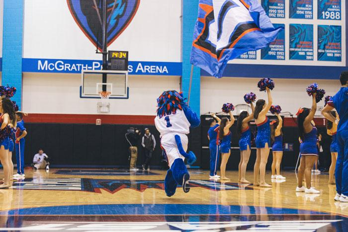 Dibs carries the Blue Demon flag with pride during the womens basketball game last week. There was a slight rise in school spirit last week with Blue Demon Week. (Josh Leff / The DePaulia)