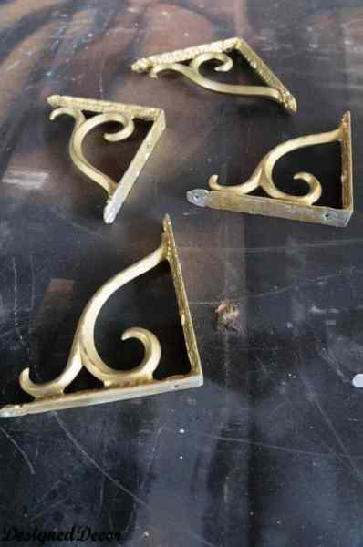 spray painting the brackets for  a Mantle Shelf-
