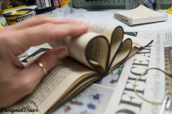 glue the book pages to make a petal for a repurposed book flower