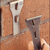 Tuesday's Tips: The trick to hanging pics on brick walls...