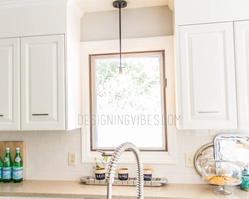white kitchen cabinets with white subway tile backsplash