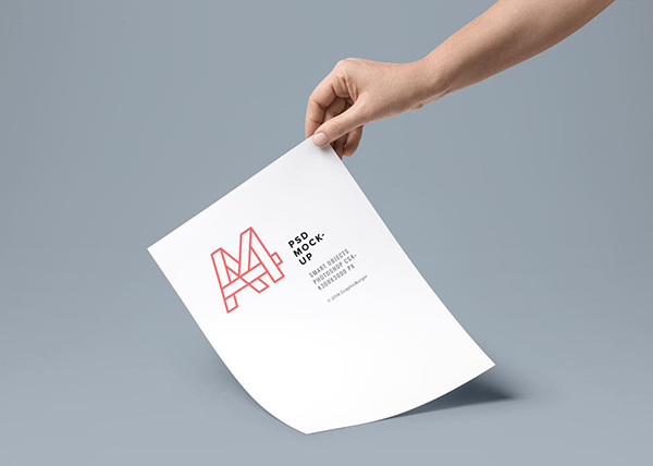 14 Hand holding A4 Paper Mockup