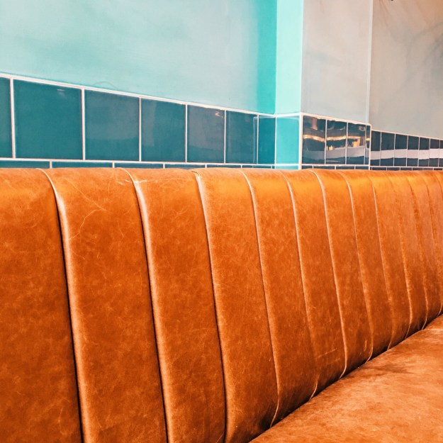 byron burger interior caramel and turquoise