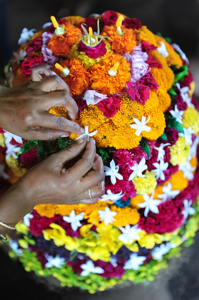 Making Bathukamma with flowers