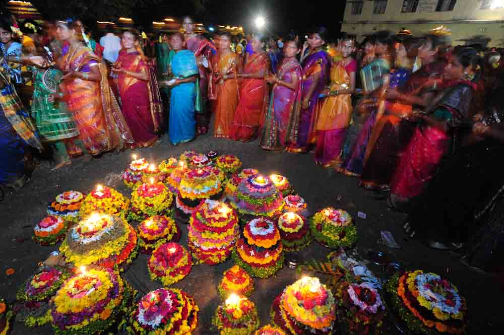 Women singing Bathukamma songs in evening