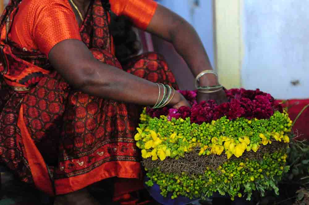 A Woman making a Bathukamma in Telangana