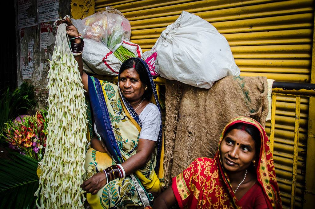 Women selling flowers in Bansphatak Flower Market Varanasi