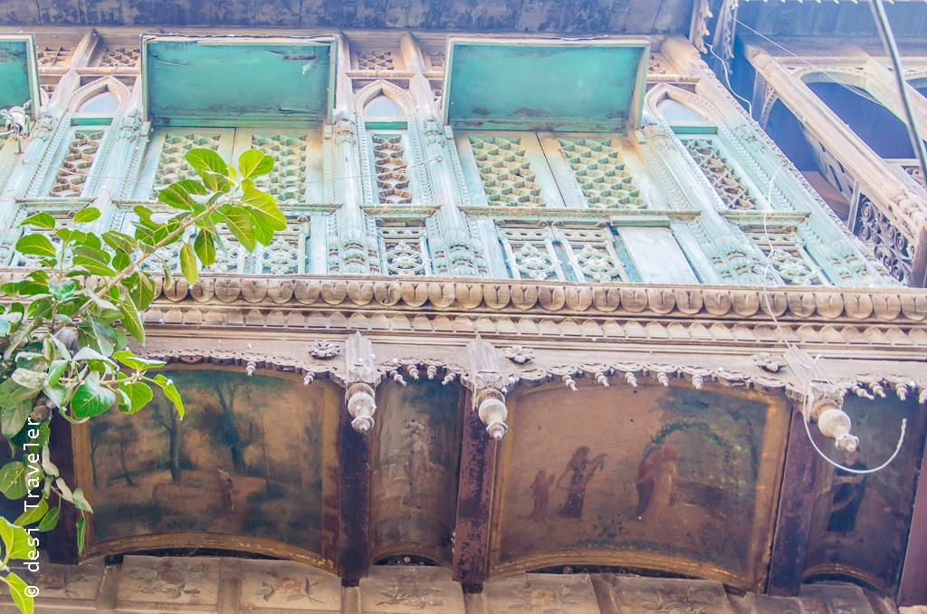 Paintings below balcony Amritsar heritage walk