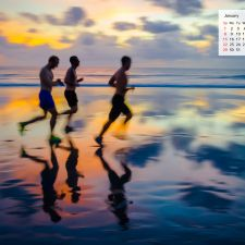 January 2017 Desktop Calendar - Runners on a beach in Bali Indonesia