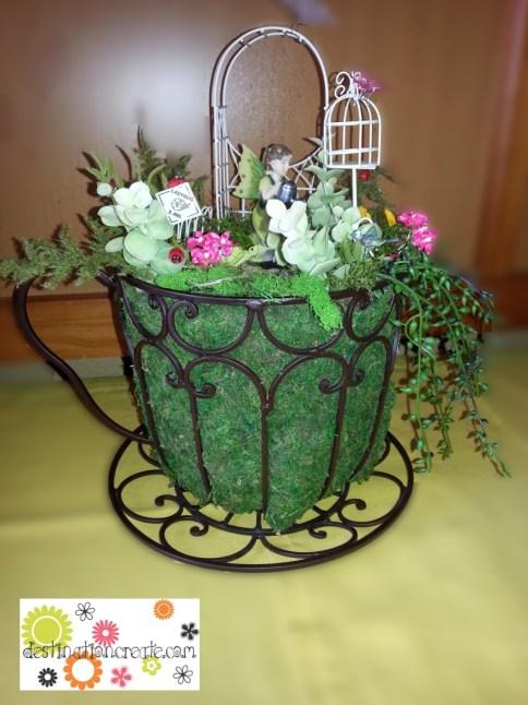 Fairy garden in a wire teacup