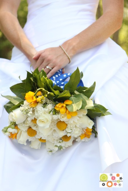 Yellow and blue wedding bouquet-white roses, carnations and stock with yellow billy balls and freesia.