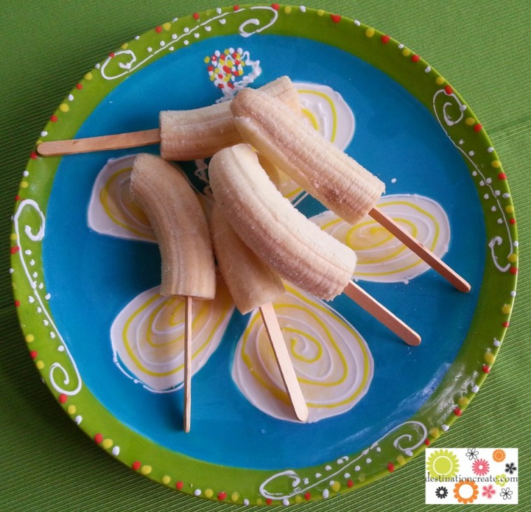 Frozen bananas prepped for dipping