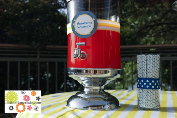 Blue and yellow wedding- flavored lemonade bar at wedding with polka dot straws and lemons
