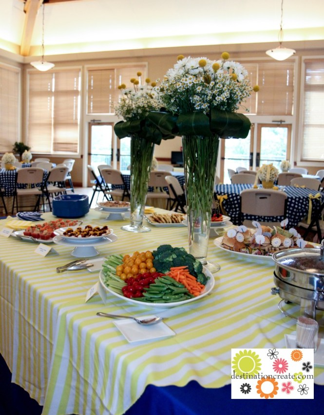 Yellow and blue wedding buffet centerpieces-white daisies, feverfew and yellow billy balls, Ti leaf collar.