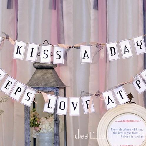 "DIY Vintage Wedding Rentals Denver- ""a kiss a day"" banner"