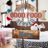 "Retro/Vintage Wedding-""Good Food"" sign invites guests to enjoy buffet"