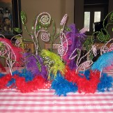 Feathers and Christmas stems create a whimsical Dr. Seuss centerpiece.