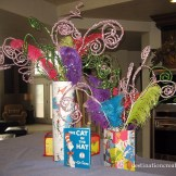 Cover glass vases with thrift store book pages.