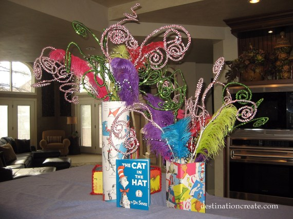 Dr Seuss centerpiece made by covering glass vases with thrift store book pages.