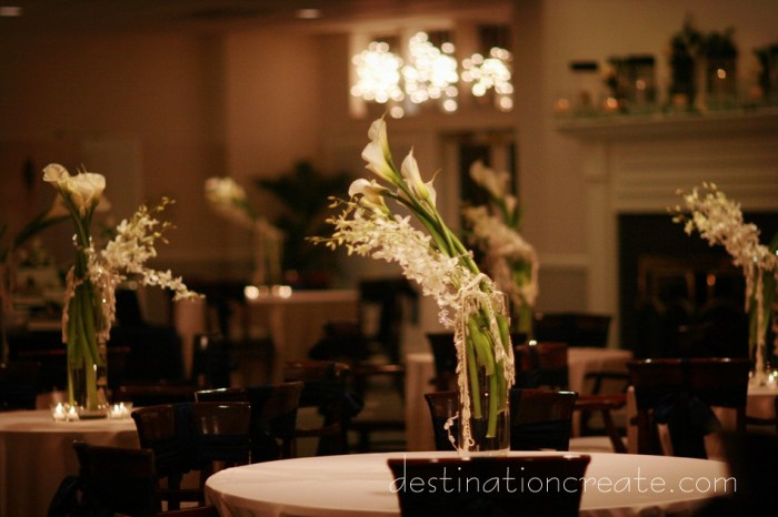 White wedding table flowers: Destination Create offers wedding planning, decorating, styling, planning & specialty rentals.