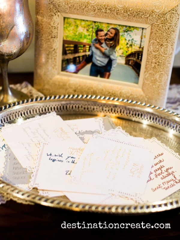 Wedding guests write their well wishes for the happy couple at this romantic blush and gold wedding in Golden Co