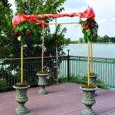 Use these 4 urns to create a chuppah or canopy for a ceremony.