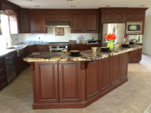 Remodeled kitchen with brown cabinets