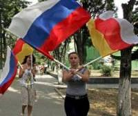 russian_and_south_ossetian_flags_woman