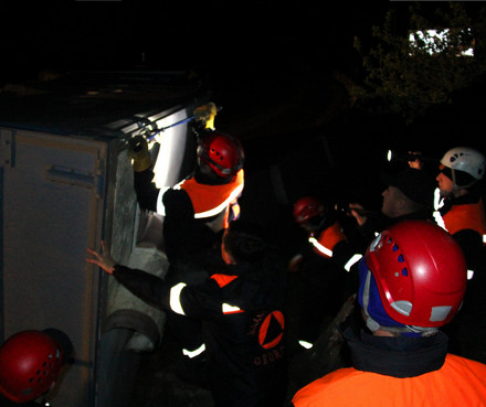 Rescue workers at the overturned truck
