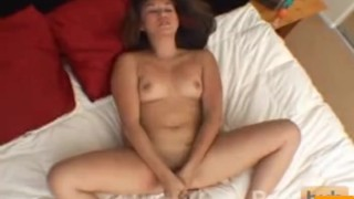 Pigtailed brunette strips and masturbates