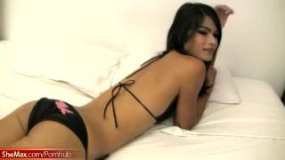 Luscious tgirl strips out of black bikini and masturbates