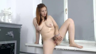 Lina strips naked to masturbate with candles