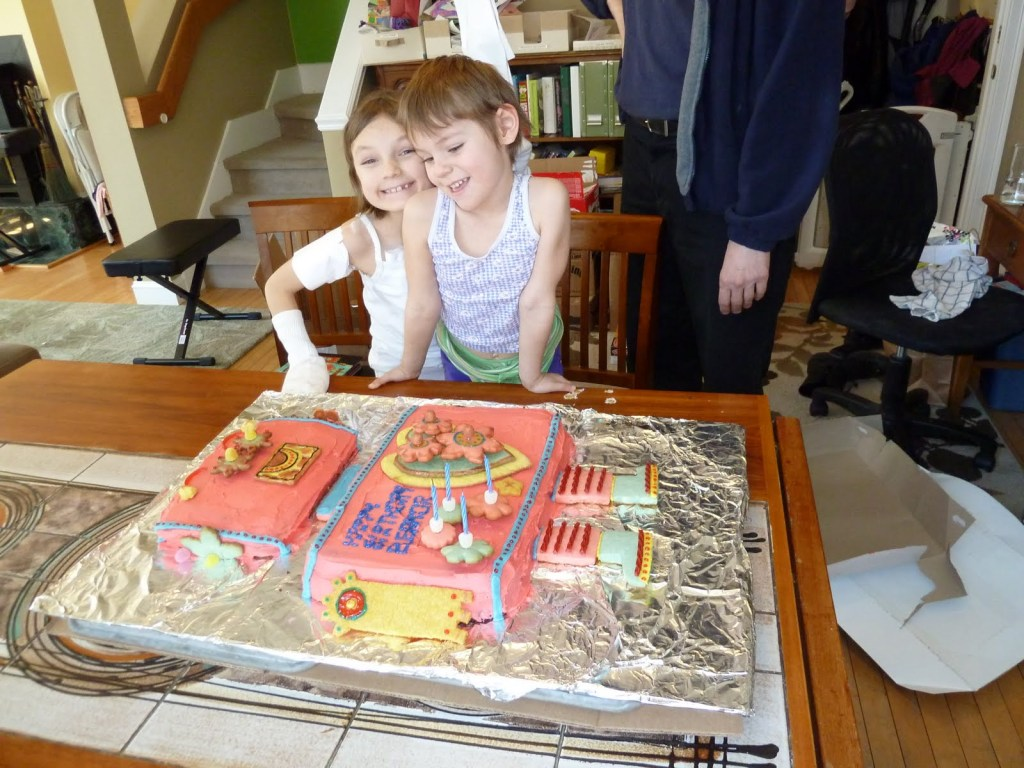 Children view robot birthday cake