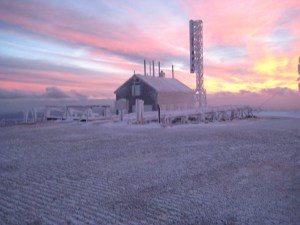 The Stage Building at sunset. This building, which serves as a depot for the Cog Railway, is a replica of the 1932 Observatory where the record wind was recorded.   The current Observatory building opened in 1980.