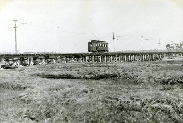 The PK & Y electric trolley doing a run on the trestle built through Brave Boat Harbor.